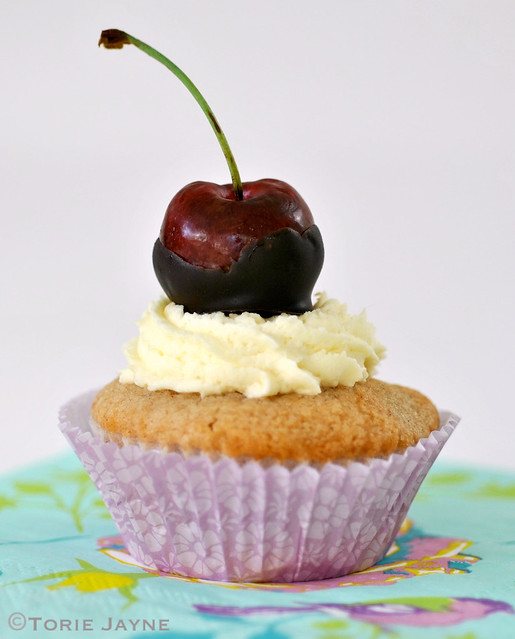 Cherry topped choc chip cupcake