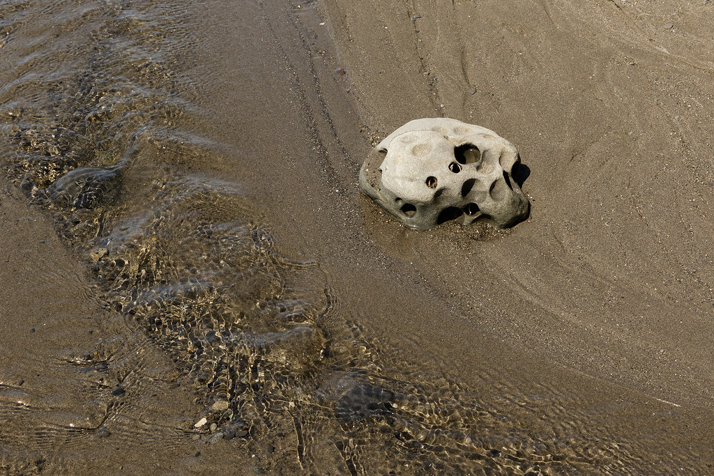A skull-like rock beside a stream on the beach at Beach 4 in Olympic National Park in Kalaloch, Washington