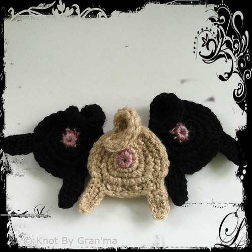 flowery crocheted pug butts by knot by gran'ma