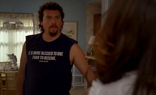 Kenny Powers wearing a tis more blessed to give than to receive tshirt