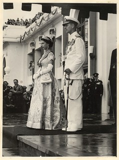 [Her Majesty Queen Elizabeth the Second and His Royal Highness The Duke of Edinburgh, standing on front steps of Parliament House, Canberra 1954]