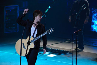 Lead singer of the Goo Goo Dolls, Johnny Rzeznik, plays acoustic guitar onstage during a live performance in Peoria, Illinois