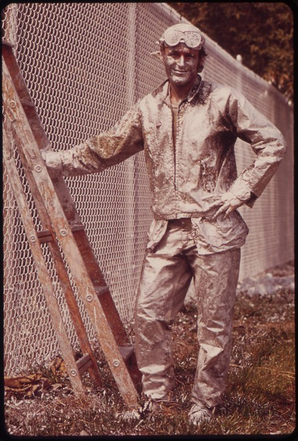 DOCUMERICA: Painter Working On Chain Link Fence, August 1973 Dick Swanson.