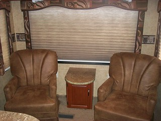 rv rear living area with 2 chairs