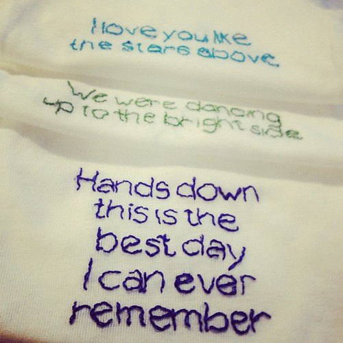 My gift to baby Drake: onesies embroidered with lyrics his mom & I sang along to (the Indigo Girls cd I bought her as a bribe, the Dasboard concert we went to)