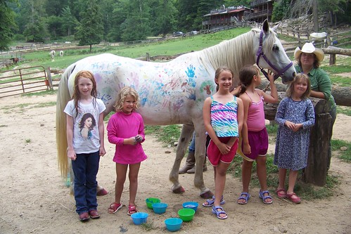 Girls and the painted horse