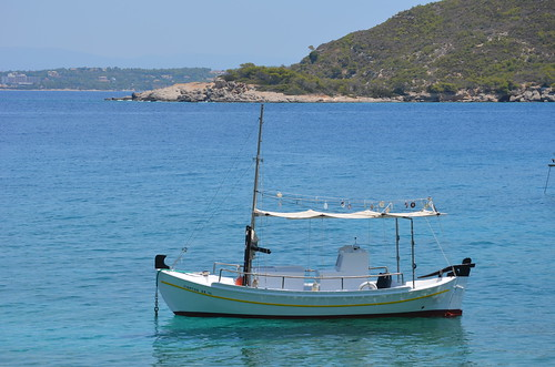 Boat on the clear Greek water