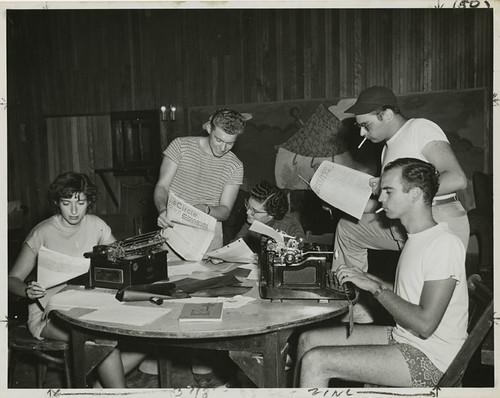 Young men and women working on writing for publications at Camp Wel-Met, 1948