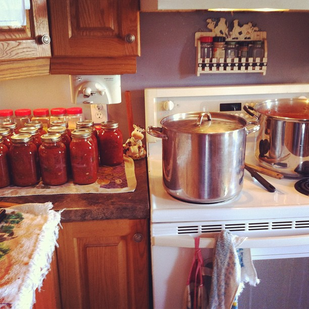Today's canning: spaghetti sauce. 13 litres done, two full stock pots waiting. Whew. #canning #fresh #garden