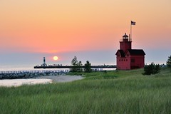 """Big Red""  Holland Harbor Lighthouse Sunset by Michigan Nut"