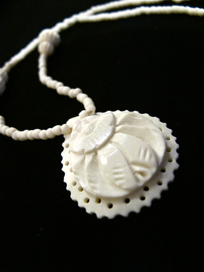 Ivory Celluloid carved necklace
