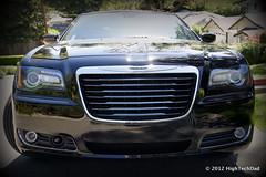 automobile(1.0), automotive exterior(1.0), vehicle(1.0), automotive design(1.0), mid-size car(1.0), grille(1.0), chrysler 300(1.0), chrysler(1.0), bumper(1.0), land vehicle(1.0), luxury vehicle(1.0),