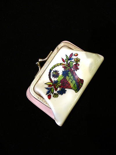 Adorable little vinyl purse with prints of a floral basket on each side
