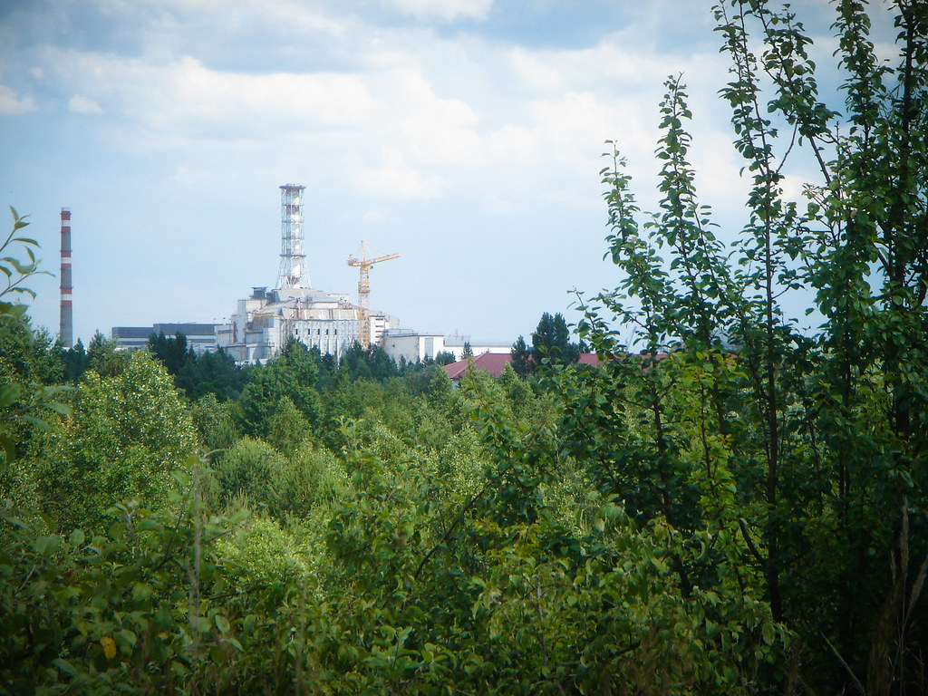 The destroyed Chernobyl nuclear power plant, as seen from Pripyat. Since the accident, the evacuated Exclusion Zone surrounding the reactor has been overtaken by vegetation and wildlife. www.visitsunnychernobyl.com