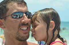 Sleepy kid in dad's arms at Surfers For #Autism: Returns to Treasure Island, Florida on 7 July 2012