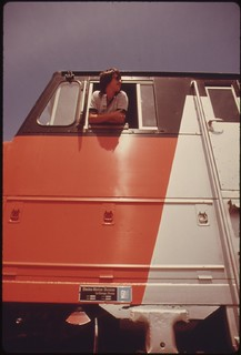 Engineer of the Lone Star passenger train waits in his cab before continuing the Amtrak train run at Pauls Valley, Oklahoma enroute from Chicago to Houston, Texas, June 1974