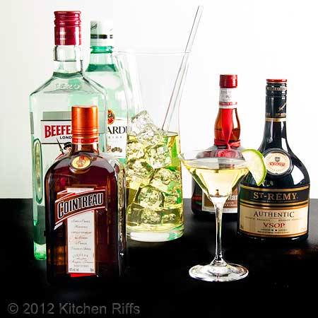 Liquor Bottles, Cocktails in Glass, and Mixing Pitcher