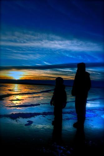 blue winter girls light sunset sun lake ice girl minnesota silhouette yellow frozen north
