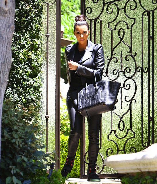 Kim-Kardashian-Nike-Air-Yeezy-2-solar-red-sneakers-Celine-leather-phantom-bag1