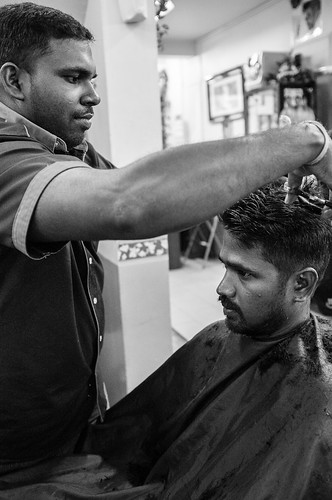 Getting a haircut in Little India, Singapore.