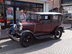 touring car(0.0), sedan(0.0), automobile(1.0), ford model a(1.0), ford model a(1.0), vehicle(1.0), ford(1.0), antique car(1.0), classic car(1.0), vintage car(1.0), land vehicle(1.0), luxury vehicle(1.0), ford model t(1.0), motor vehicle(1.0),