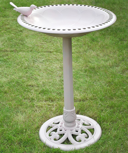 Pink spray painted birdbath