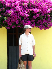 Jak stands beneath the ubiquitous bougainvillea