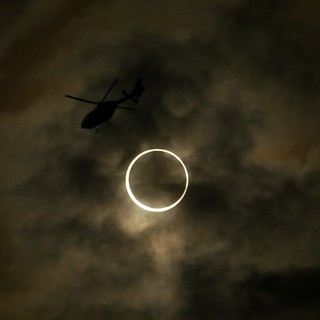 Helicopter passes by right at the moment of totality! (GH1 camera)
