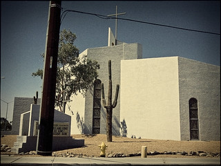 church with cactus and power pole