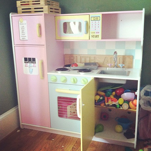 I thought the play kitchen looked unusually clean...until I opened the cabinet...Ruth Ann has adopted her Daddy's favorite method of cleaning!