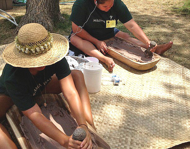 <p>Summer Maunakea and Ulu Cashman pounding taro at the University of Hawaii exhibit at the Smithsonian Folklife Festival.</p>