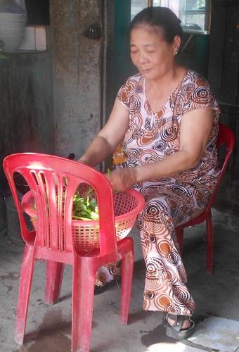 Ms. Nguyen Thi Cuc prepares greens in her restaurant, Kim Cuc