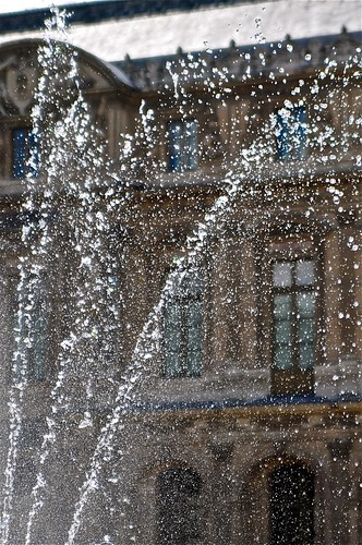 a fountain at the louvre