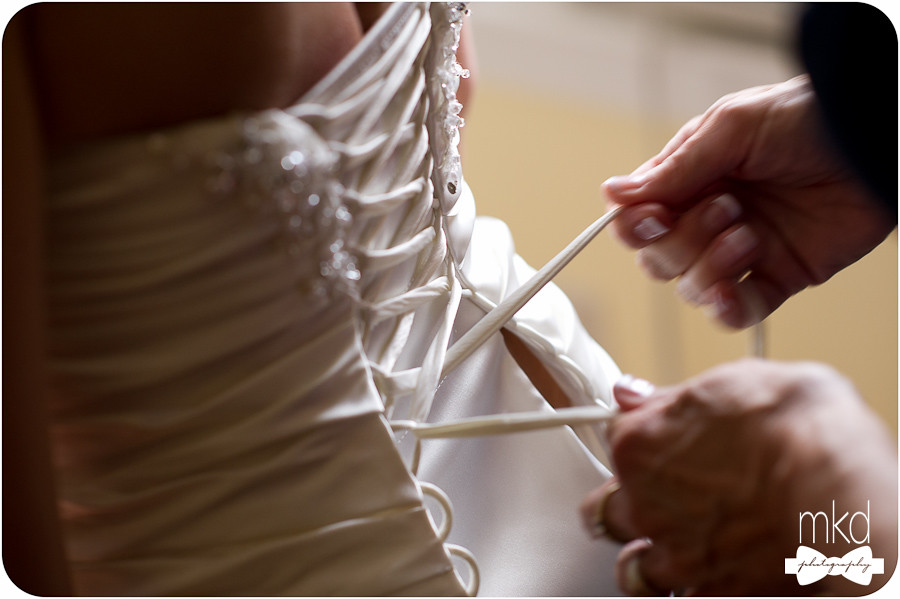 Lacing the wedding dress