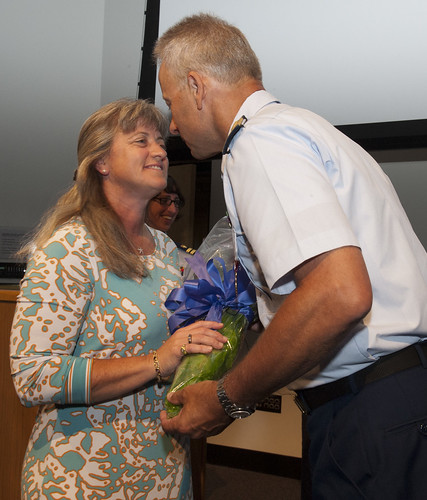 U.S. Coast Guard Capt. Richard Gaines thanks his wife Andrea Gaines during his retirement ceremony held at the U.S. Coast Guard Academy in New London, Conn., June 15, 2012. Andrea was the associate head women's basketball coach at the academy for the past 19 years and is a licensed Coast Guard captain. U.S. Coast Guard photograph by Petty Officer 3rd Class Diana Honings.