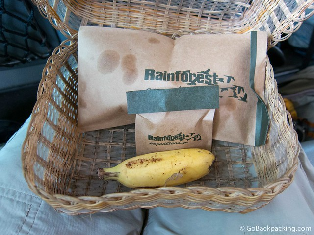 A snack basket, including banana, brazil nuts, and banana chips