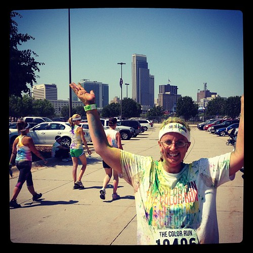 JPAD:14: Building. Here I am after the color run with the Omaha skyline behind me.