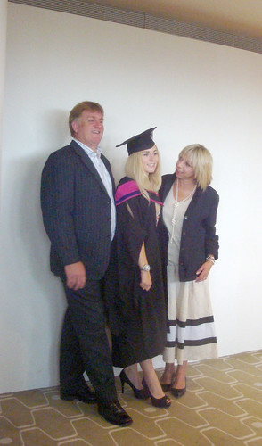 Proud parents and their daughter width=