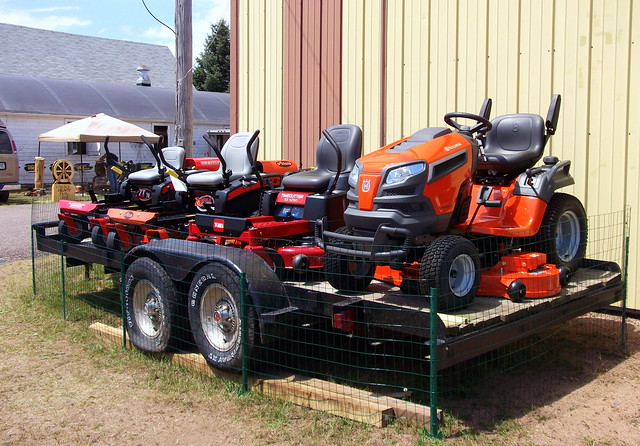 riding lawn mowers on a trailer flickr photo sharing