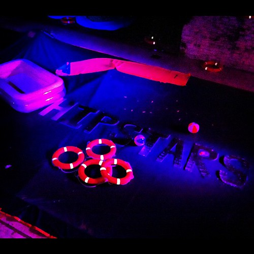 You know it's a scenester party when the pool is covered in giant Helvetica and bathed in neon. #youknowyoureahipster