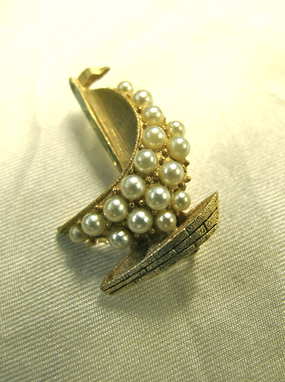 Sail the seven seas with this lovely pearly sailboat brooch!
