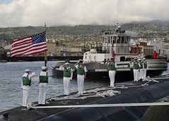 PEARL HARBOR (June 14, 2012) Sailors salute as the Los Angeles-class attack submarine USS Tucson (SSN 770) shifts colors following its return to Joint Base Pearl Harbor-Hickam. (U.S. Navy photo by Mass Communication Specialist 1st Class Ronald Gutridge)