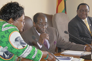Republic of Zimbabwe Vice-President Joice Mujuru with President Robert Mugabe and ZANU-PF National Chairman Simon Khaya Moyo at a politburo meeting on June 28, 2012. The party has been in power since 1980 after leading the struggle for liberation. by Pan-African News Wire File Photos