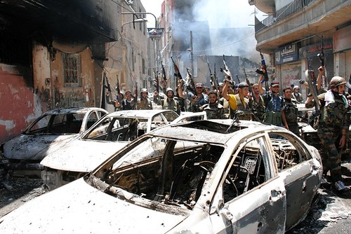 Syrian soldiers in Medan on July 20, 2012. The military has retaken areas invaded by the US-backed rebels fighting the Assad government.  by Pan-African News Wire File Photos