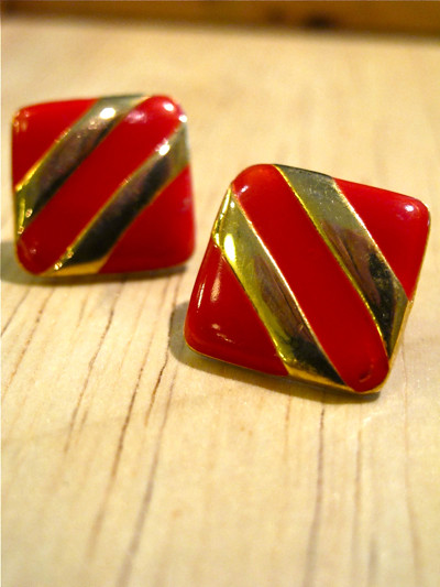 Striking red enamel and gold-tone earrings.