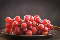 Bunch of red grapes on dark background