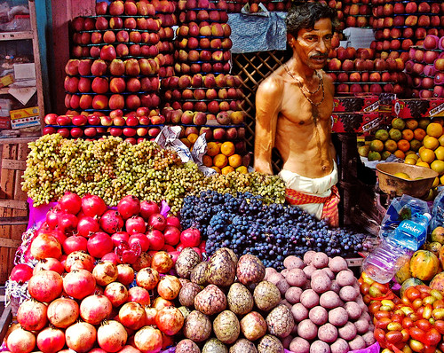 A villager at a roadside stand