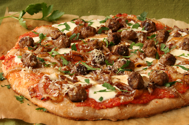 pizza with lamb meatballs, caramelized onions, and parsley