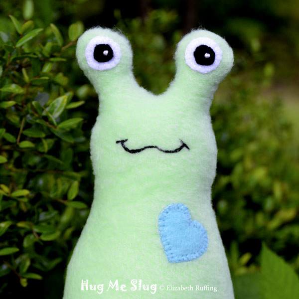 Mint green Hug Me Slug, original art toy by Elizabeth Ruffing