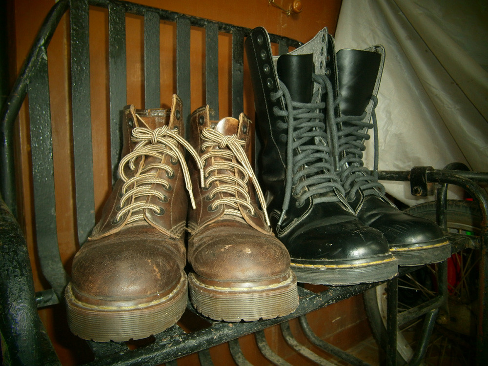 Brown 8-hole Doc Martens and Black 14-hole Doc Martens